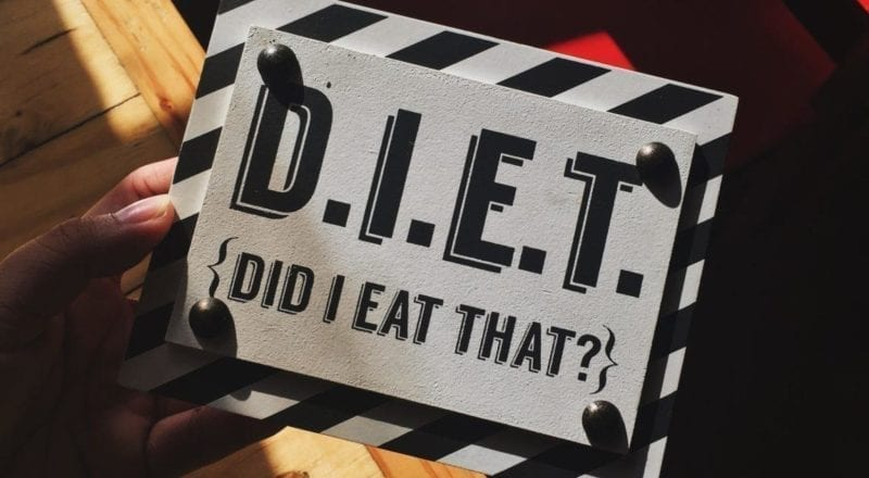 A diet sign held by someone who knows the importance of dietary requirements